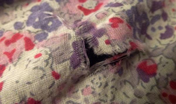 3 corner tear in skirt