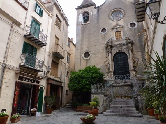 Cefalu church facing salita with socks store