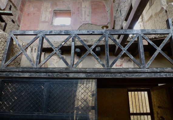 Herculaneum charred wood second story balcony screen