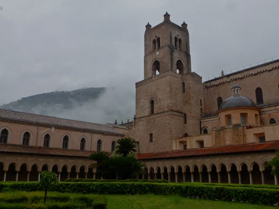 Monreale cathedral rear from cloister with tower cloud breaking up