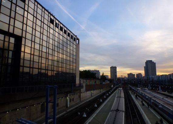 Montparnasse trainyard sunset reflected
