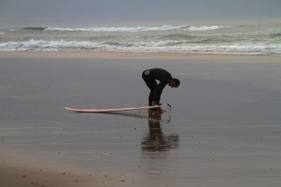 Biscarosse plage surfer prepping marine layer
