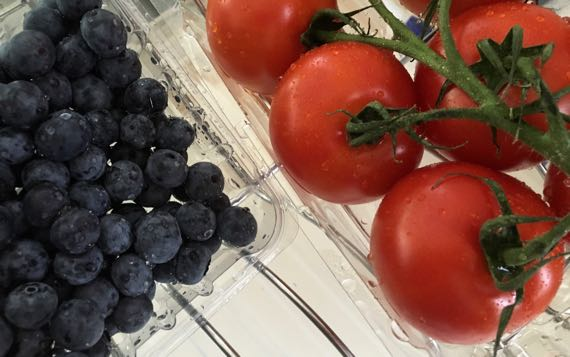 Blueberries tomatoes plastic packs
