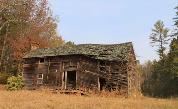Decomposing clapboard house