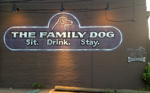 Family dog building sign before dawn