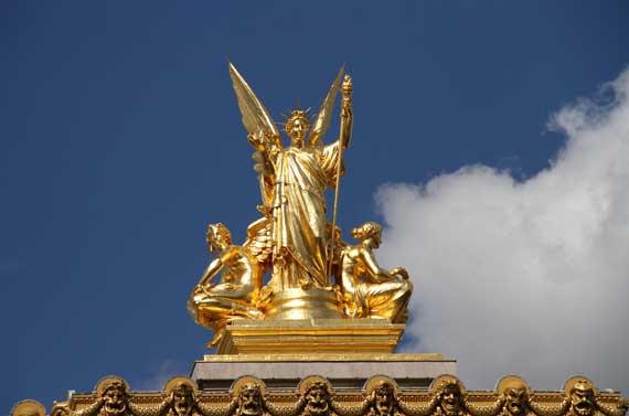 Golden rooftop statue paris island