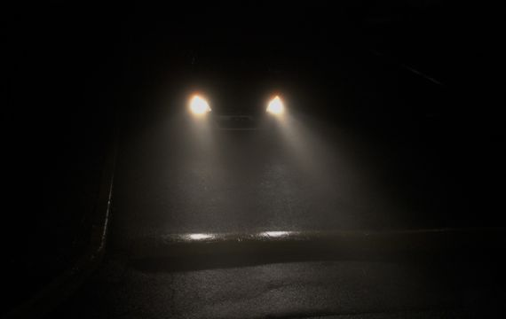 Headlights in Xmas Eve fog city