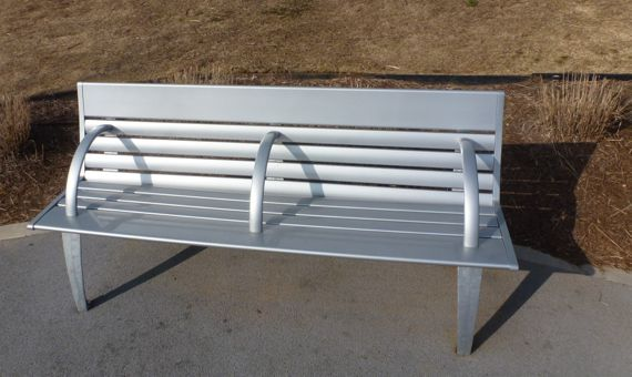 New old 4th ward park bench in sun