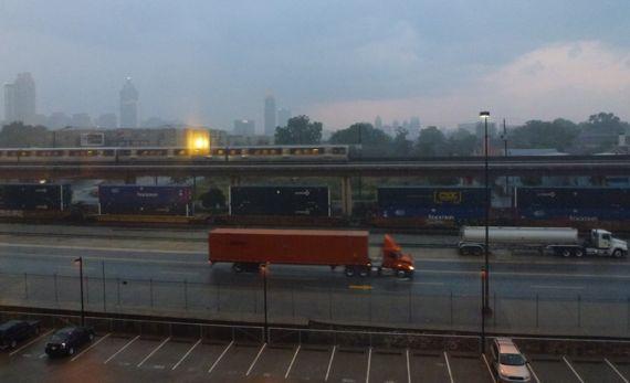 Red truck train rain