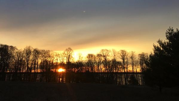 Sunrise golden ball obscured