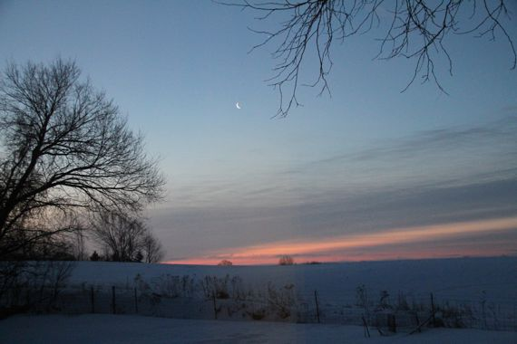 Sunrise over snowy fields and beyond