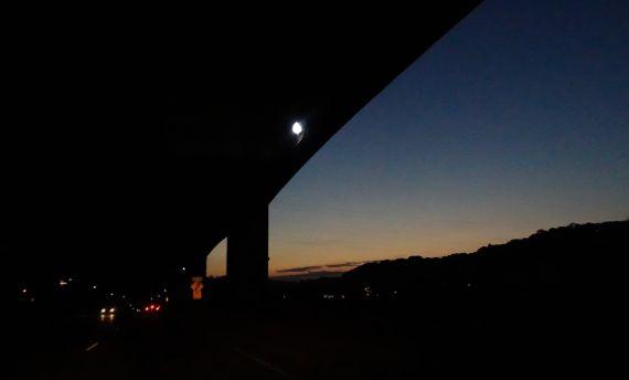 Sunset through bridge