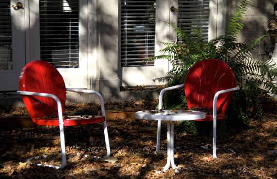 Two red patio chairs