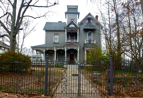 Victorian on hill with fence