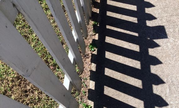 White picket fence n shadow